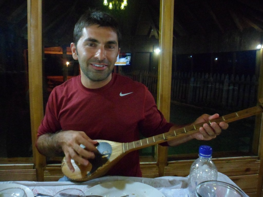 Rezart shows us how to play a çiftelia at dinner