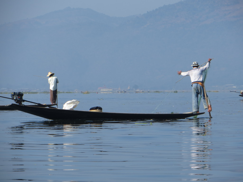 Fisherman on Inle Lake. You can see his leg wrapped around the oar while he's doing whatever fishermen do.