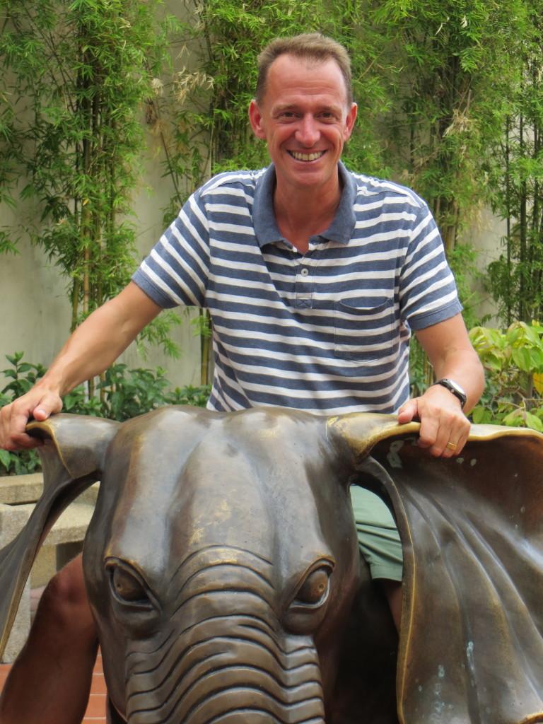 Mark was pretty happy riding an elephant statue