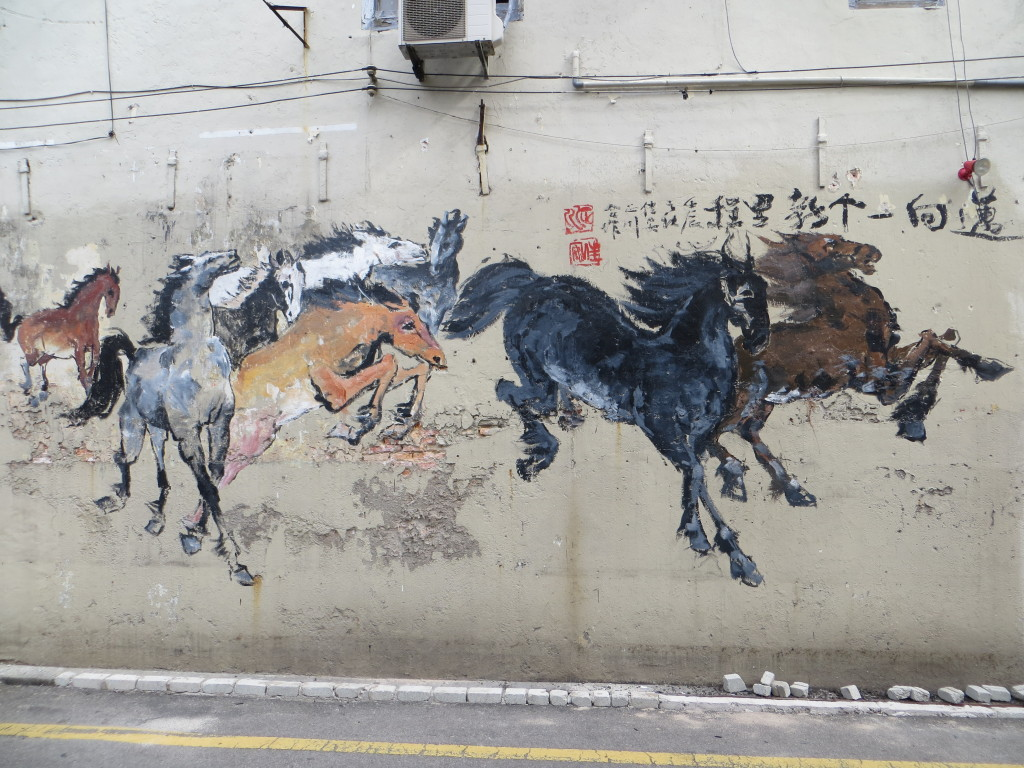 Art on a wall in the city reminding us it's now the Year of the Horse