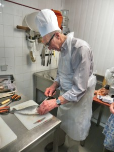 Paul cleaning fish for dinner. Paul is 79 year old and bikes more than someone half a century younger (and he has a great dry sense of humor). May we all age so well!
