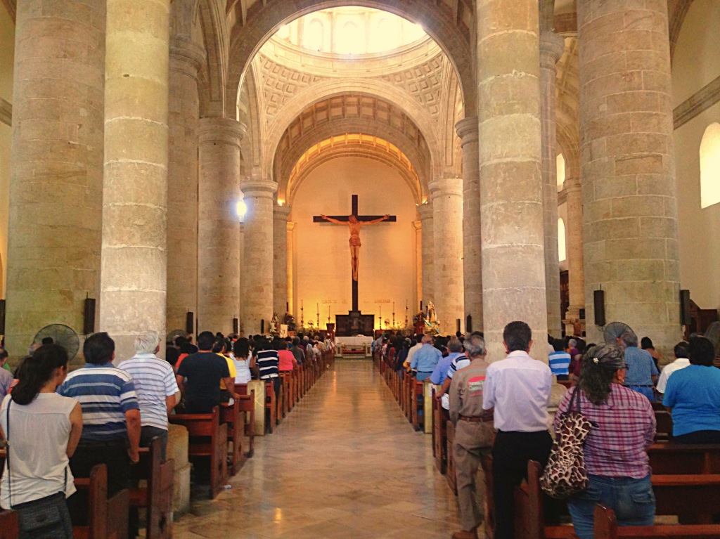 OK, I know this was a religious ceremony. There's a big old cathedral on the Plaza Grande and I went in to look around on Sunday morning. What's interesting to me is that big churches all over Europe are beautiful but largely empty, even on Sundays. In Catholic Mexico, though, there were hundreds of people here for services. Hundreds.