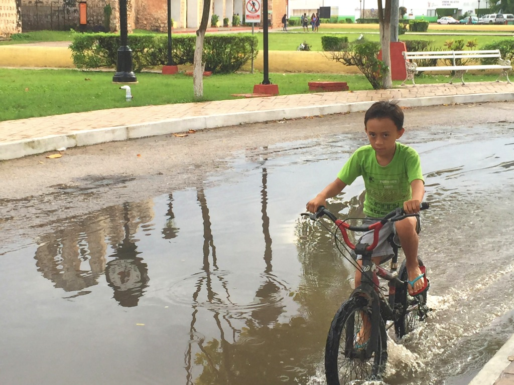 A terrific rain storm came and went in a short time, leaving some fun flooded streets for this guy