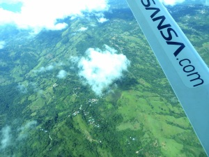 Flying above the lush green landscape of Costa Rica