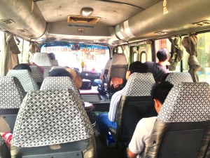 Our old, rickety bus to Hue. The guy standing at the door on the right is watching for anyone who looks as though he or she needs a ride north.