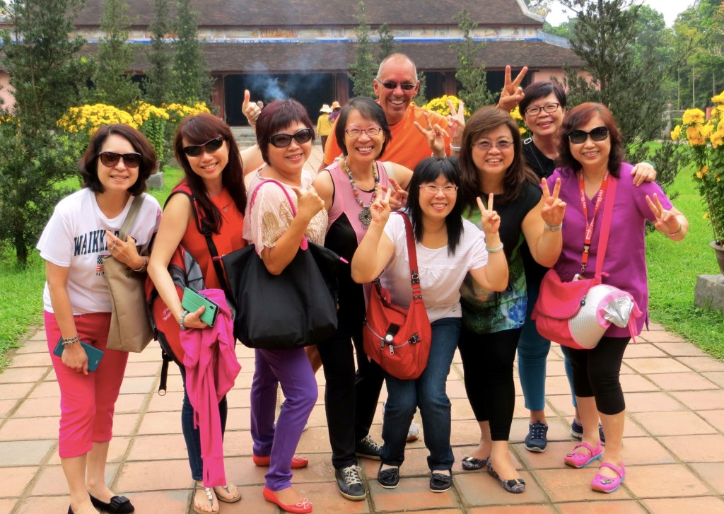 Jim photo bombing a group of Singaporean women touring one of the mausoleums