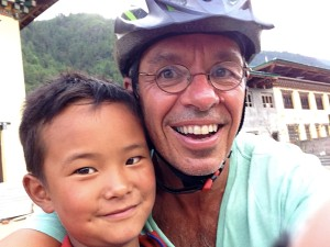 When riding our bikes in Bhutan we encounter lots of cute kids who like to run along side us and prove that they can run as fast as we can bike.