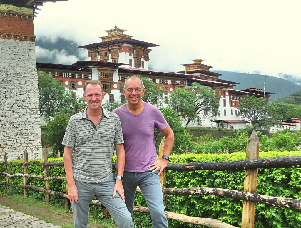 "Posing in front of the Punakha Dzong, a 17th century building that's the second oldest in Bhutan. If you're wondering, a ""dzong"" was built as a fortress, combining defense, civil administration, and religious spaces all in one."