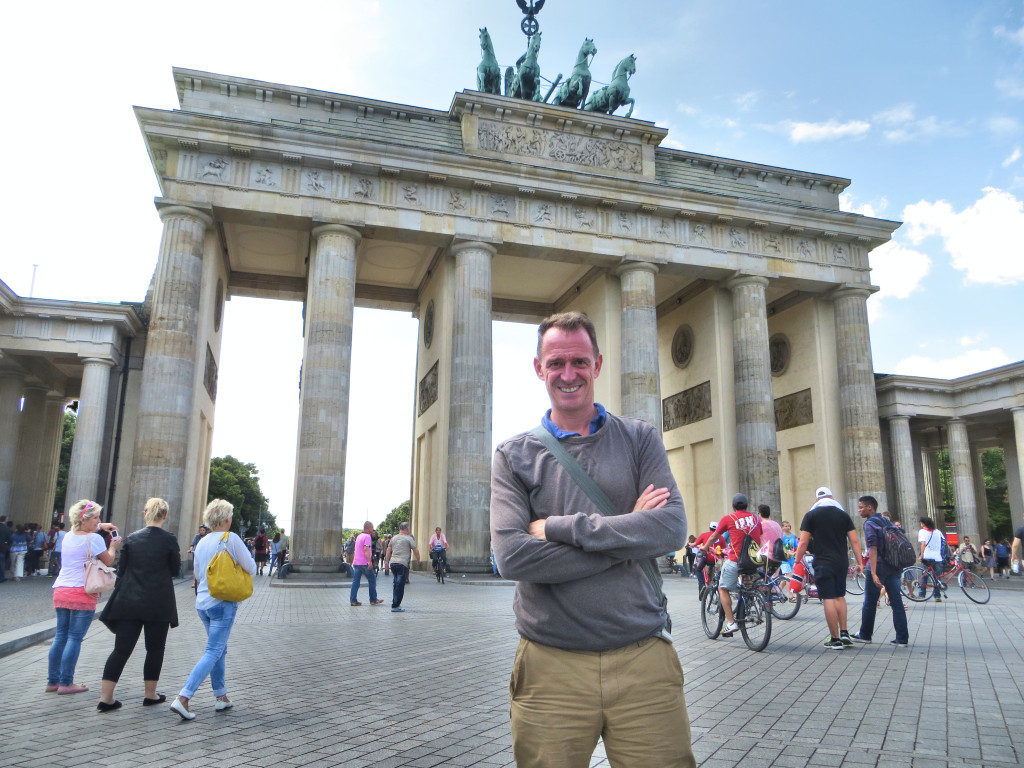 Mark in front of the restored Brandenburg Gate, this time standing in the former East Berlin