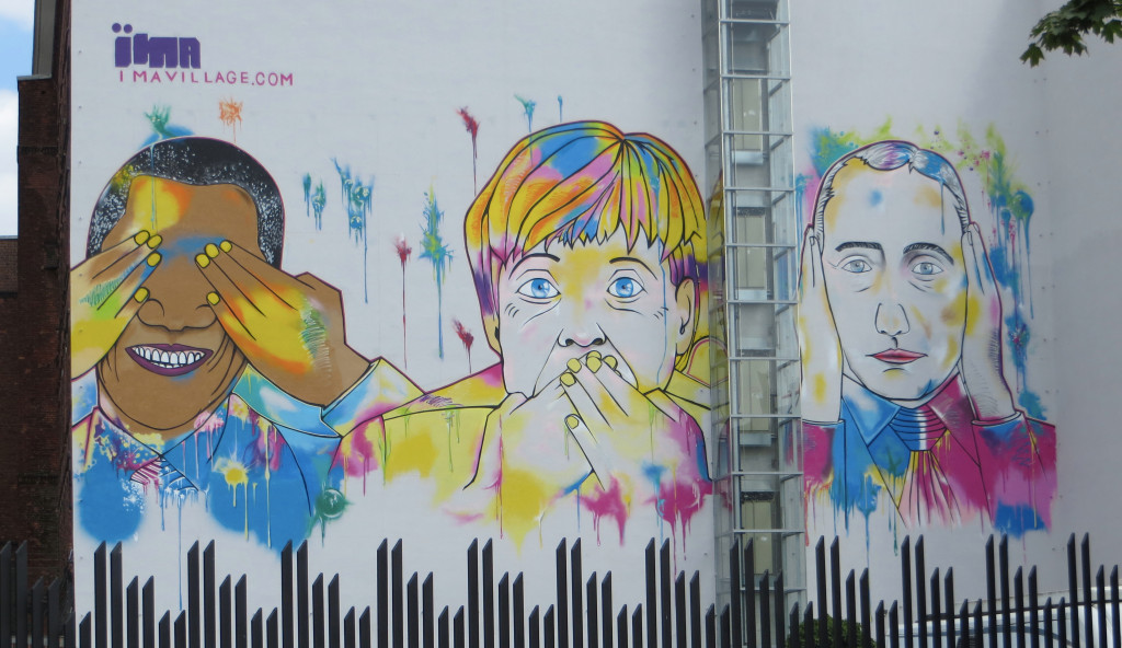 Berlin graffiti. Not at all sure what Obama, Merkel, and Putin have in common, but it was amusing.
