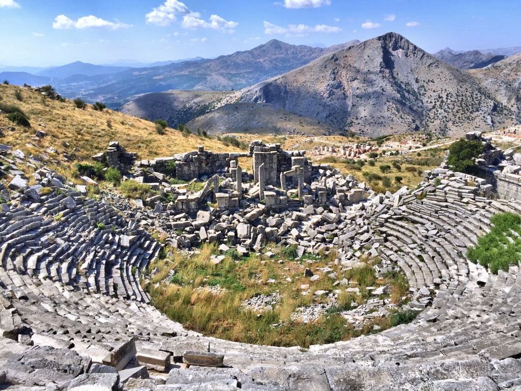 The theater at Sagalassos with stunning views ov the valley below and mountains beyond. Alexander the Great conquered the area and brought it into the Greek orbit, so that big hill in back is called Alexander Hill.