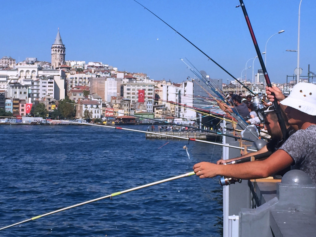 The fishermen of Galata Bridge, with the Galata Tower in the background