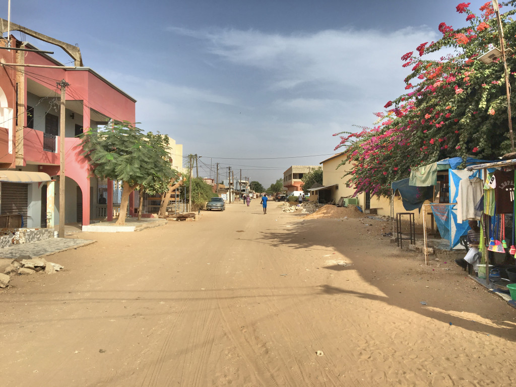 Sand. Sand everywhere. A typical street in Mbour.