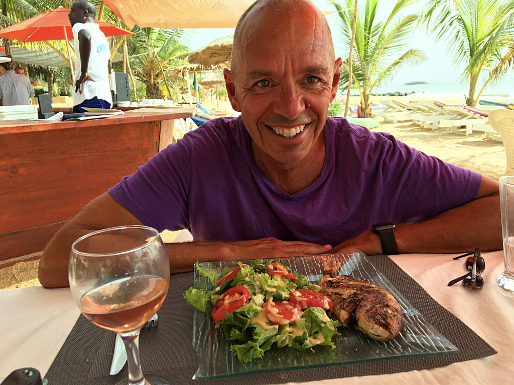 That's a very fresh fish, an equally fresh salad, and a glass of rosé at Cristal's, on the beach in Mbour a day or two before Christmas. You don't need much more than that to stay happy.