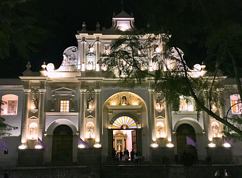 The modern Cathedral of Santiago lit up at night.