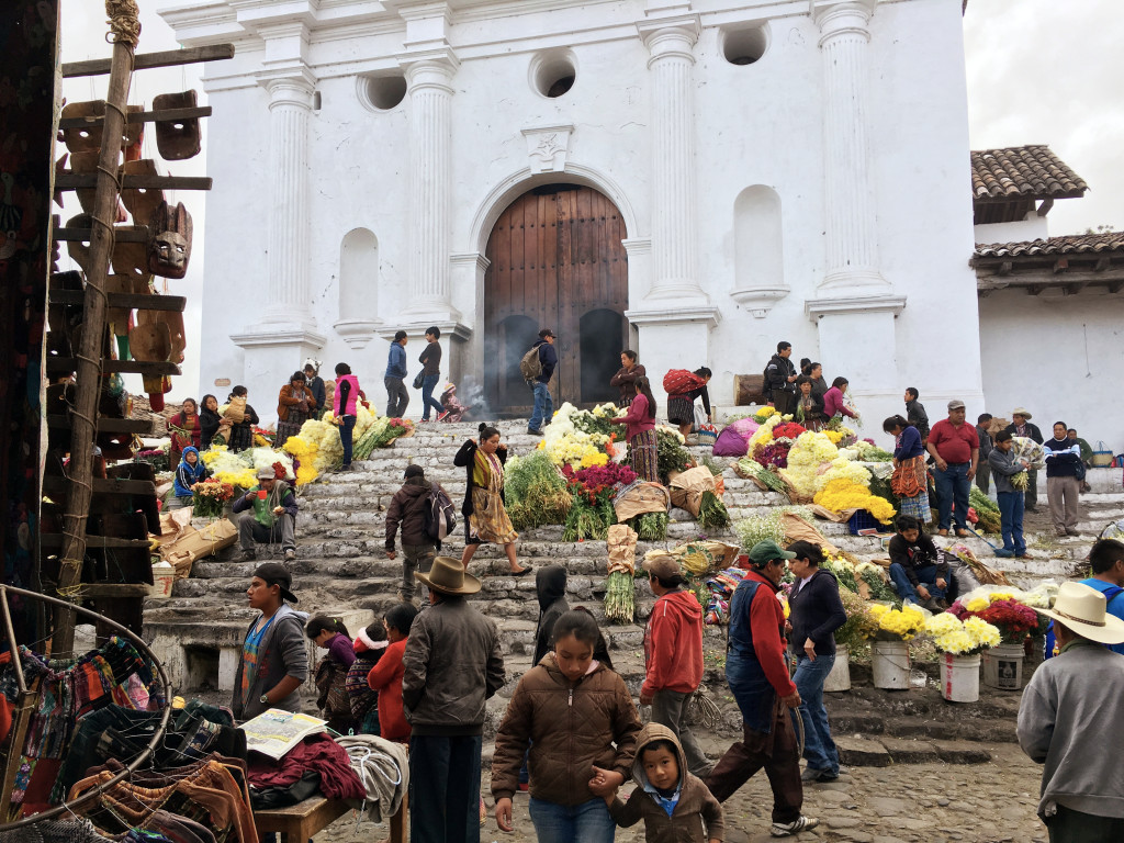 The steps of the Church of St. Thomas, where the local flower market occurs on market Sunday. Note the woman up by the door swinging her incense.