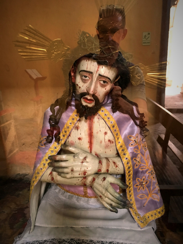 Of course, the monastery was a place for worship. Latin Americans love to emphasize Christ's suffering, as this bleeding Jesus attests to. And yes, that's Mark's reflection hovering over Him.