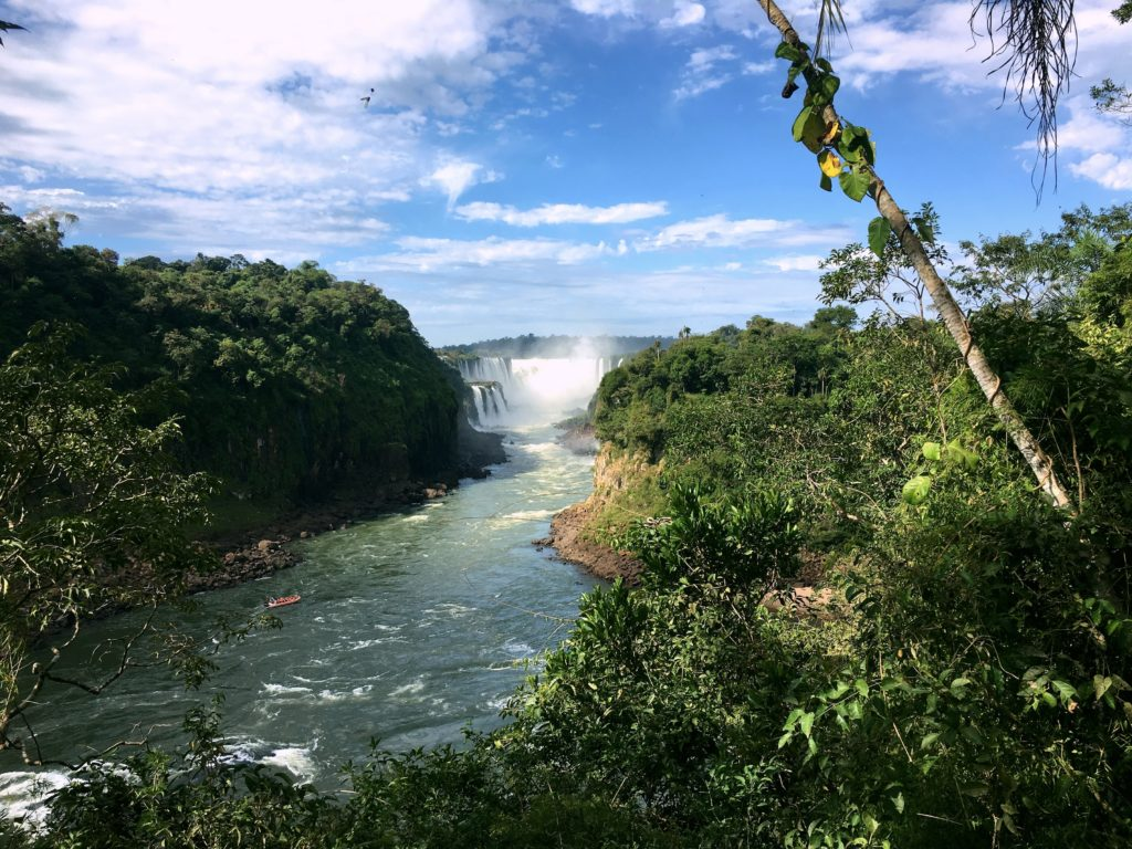 This is the Iguazu River continuing after Devil's Throat, Brazil on the left and Argentina on the right. That little orange boat is like the one we rode up the river for our showers.