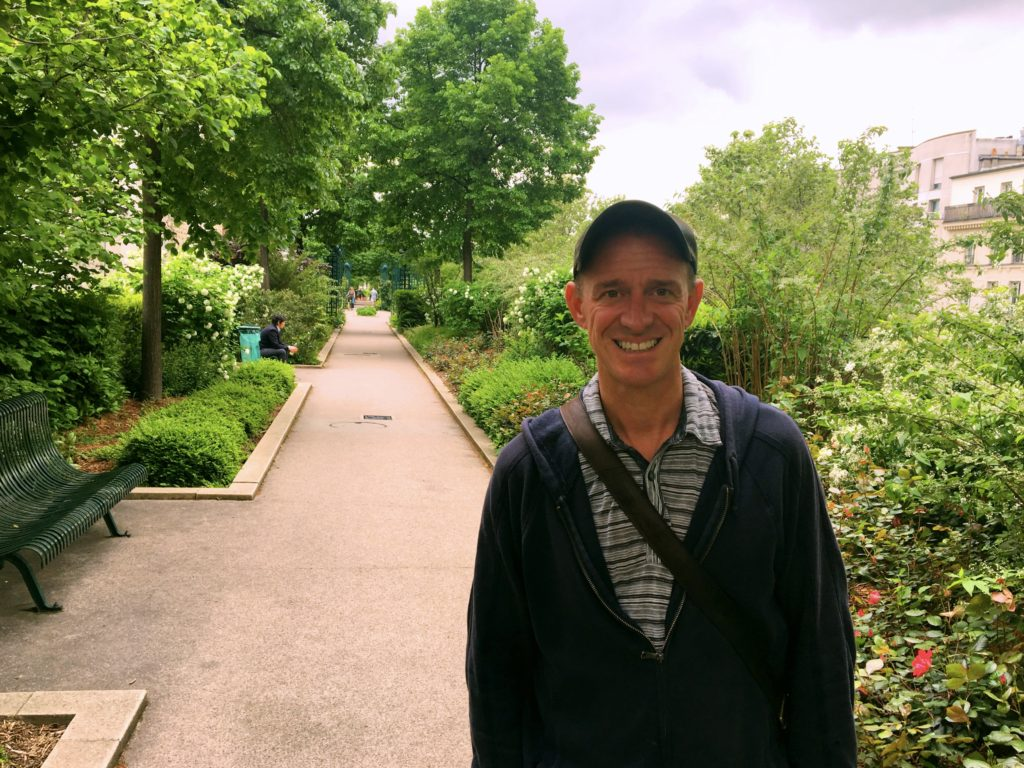 Mark along the Promenade Plantée. The city - traffic and all - is below us.