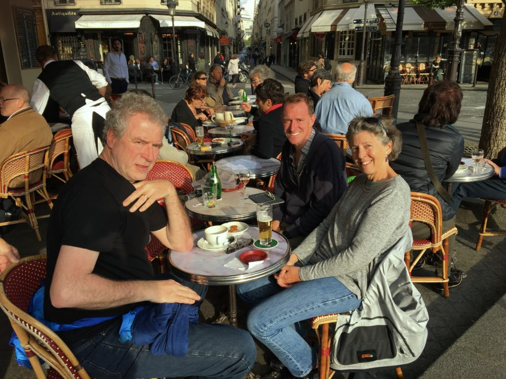 Then of course there was all the eating and drinking. Here we are at a café on the Seine, during a rare break in the weather.