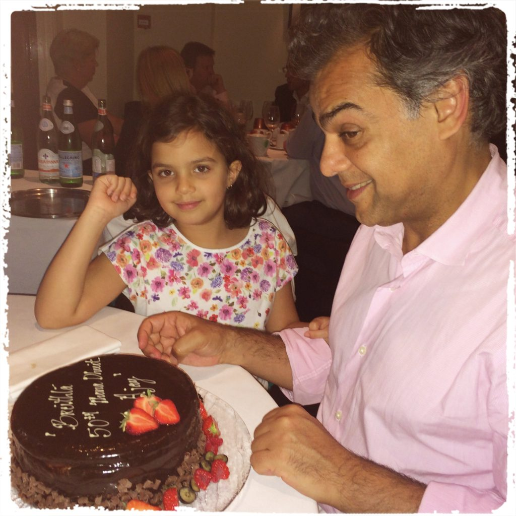 Ajay with his eight-year-old daughter Lucia and his 50th birthday cake