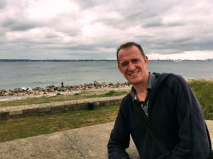 Mark at Kronborg Castle, with Sweden visible across the channel