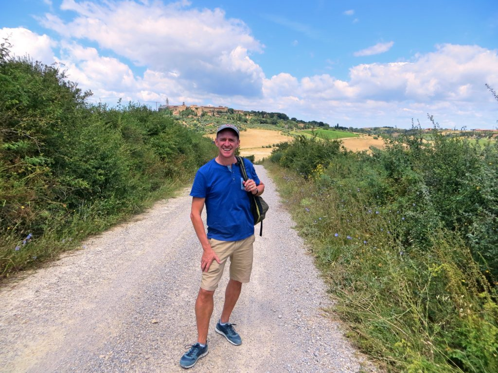 Mark on the walk, with Pienza behind him