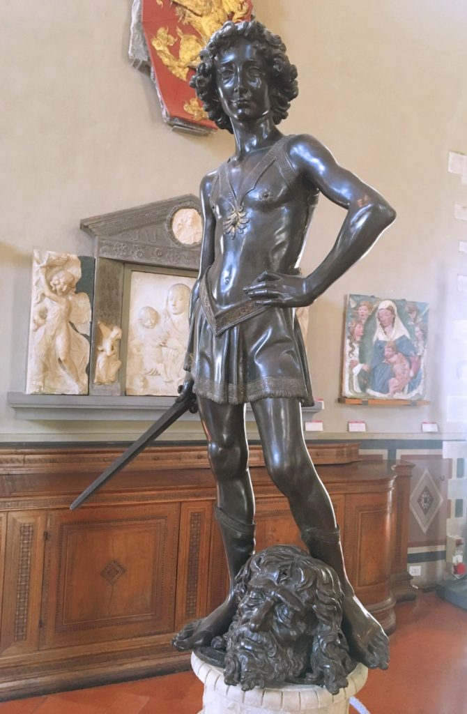 Here's Verrocchio's David, also in the Bargello. Not quite as masculine as Michelangelo's.