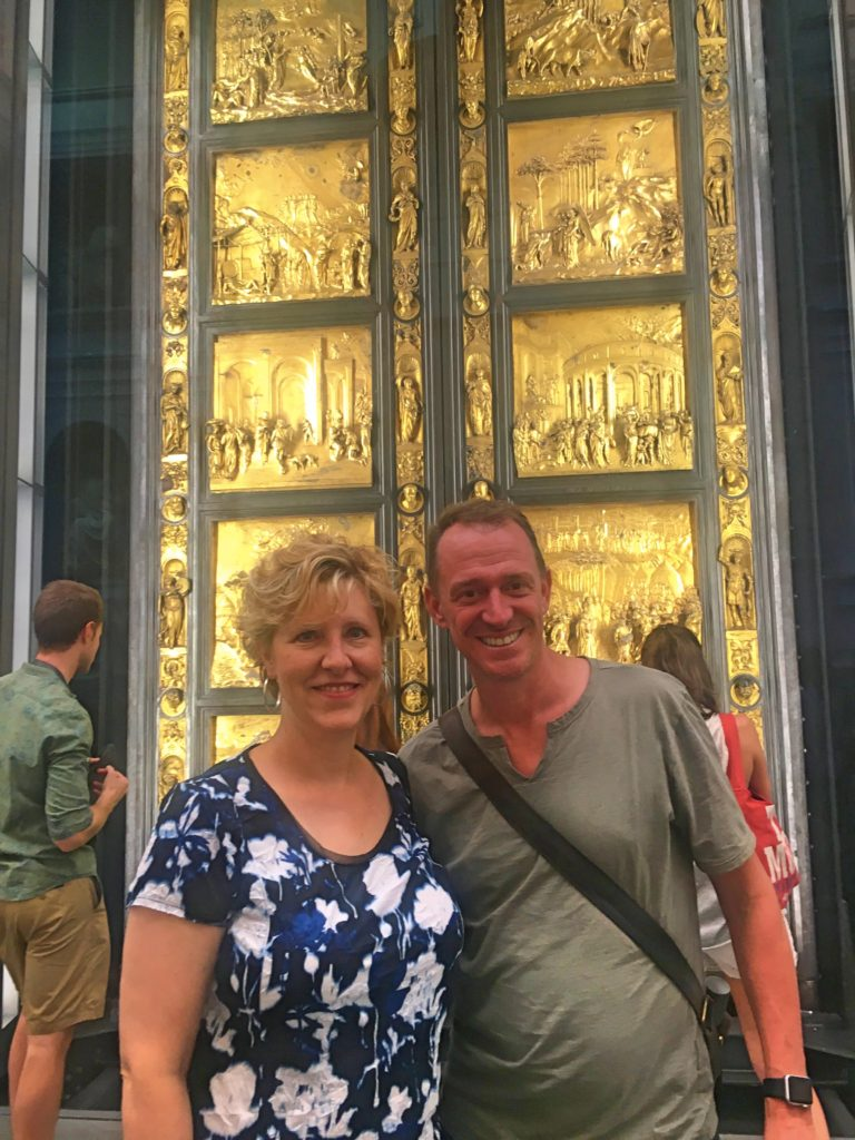 Laura & Mark in front of the original doors to the Baptistry of St. John, now kept in the Grand Museum. Created by Lorenzo Ghiberti in the early 15th century, Michelangelo called them the Gates of Paradise.