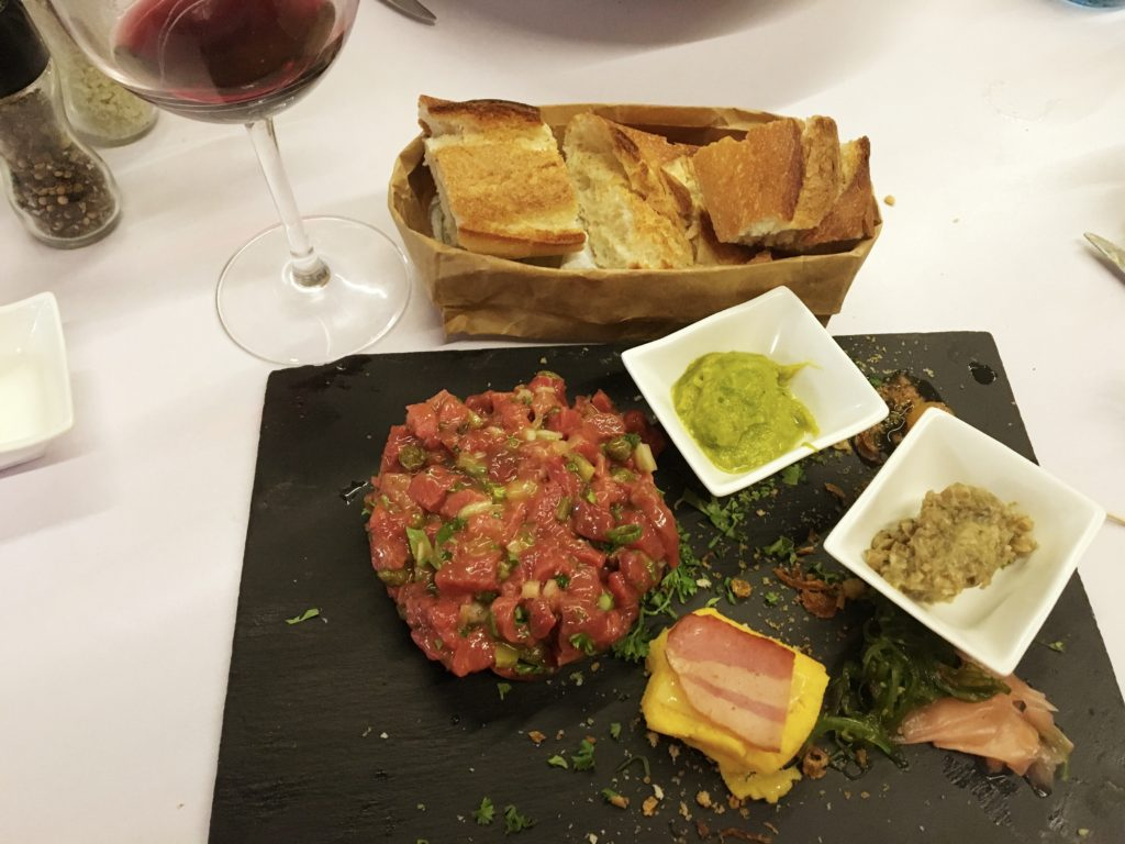 Steak tartare at So Food, with garnishes representing flavors from around the world