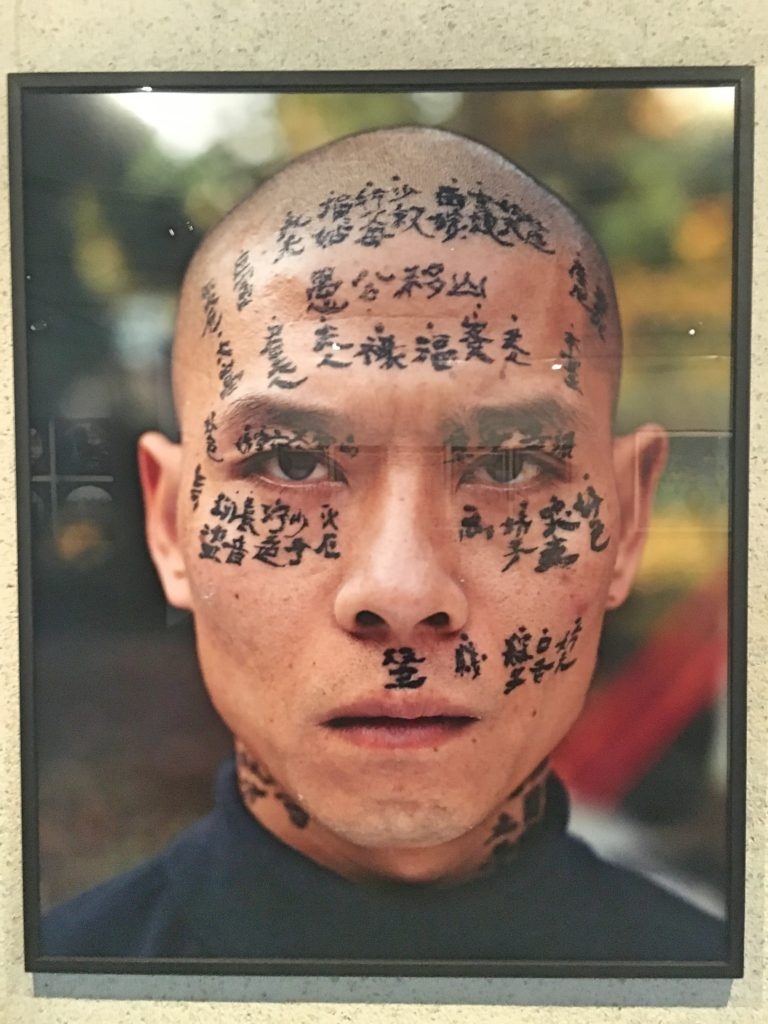 This is Zhang Huan, a contemporary Chinese Artist. He had three calligraphers spend a day writing on his face and neck relating family and traditional stories about fate. It starts slow until his entire head is just glossy black. You had to see it.