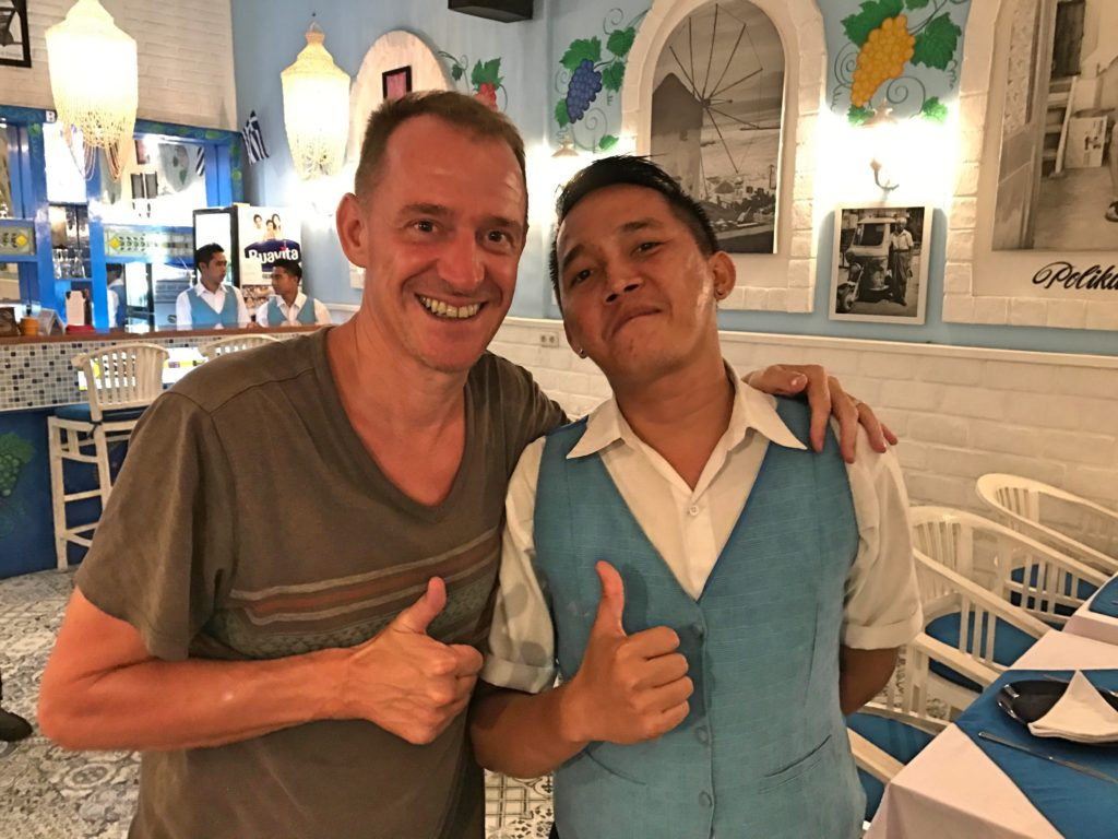 And Mark with one of the many attractive men serving at My Greek Taverna. (The owner is gay and he seems to have a decided preference for what the staff should look like.) Everybody here is happy.