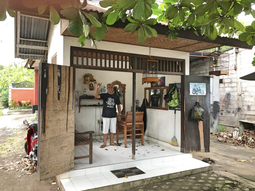 While Lovina was sometimes quieter than we would have liked, we got a kick out of the small town nature of it, too. This was my barber in his tiny shop. When I walked in he knew who I was; he lives just a few buildings away from our villa on Gang Padma.