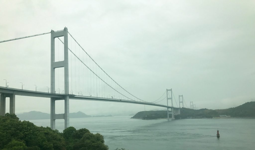 The Kurushima Kaikyo Bridge, the world's longest suspension bridge. And we bicycled over it in the rain!