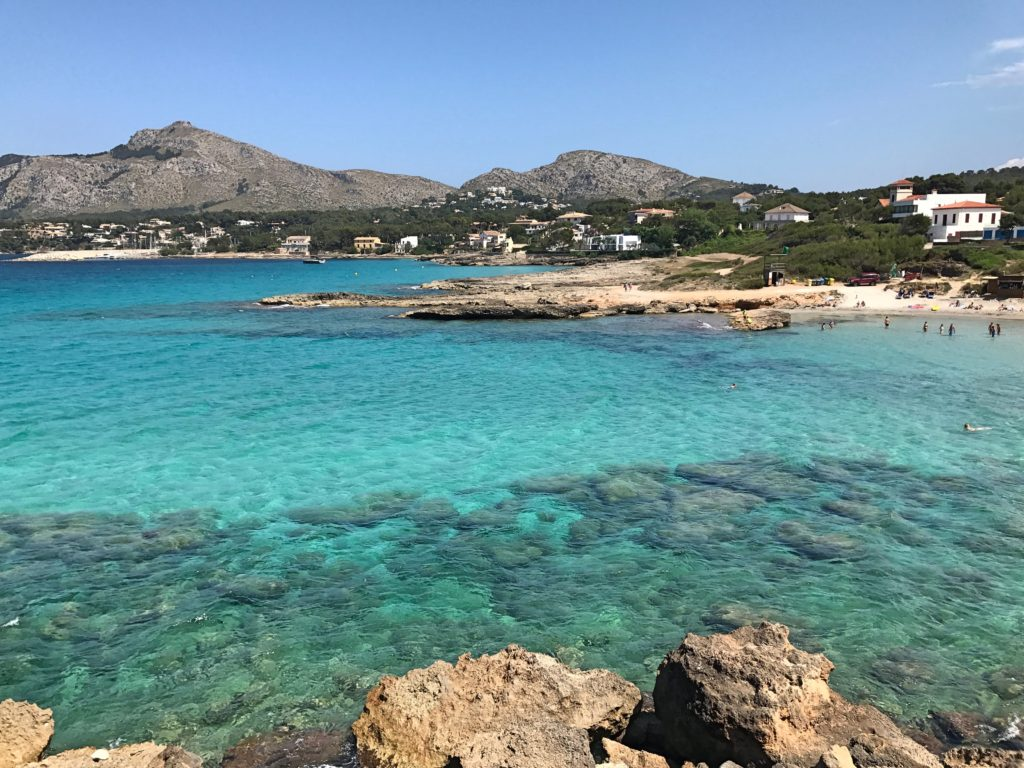 Two of the beaches in small coves in the Bay of Pollença