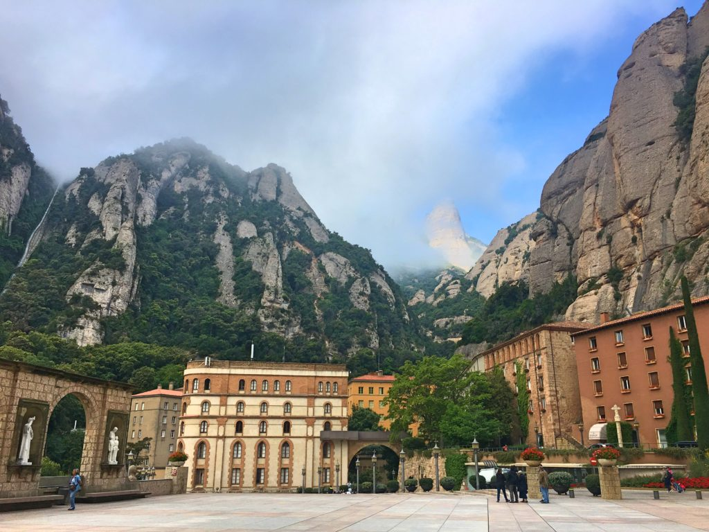"In Catalan ""Montserrat"" means ""saw (or serrated) mountain"", with the mountain in the background just one of the ""teeth"" when seen from a distance"
